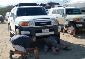 FJ Cruiser owners compete performing a tire change with minimal tools at an event in Hungry Valley, California. Photo courtesy of David Lee