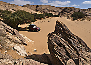 A secluded guelta provides a welcome natural shelter from the seemingly ever-present desert wind.