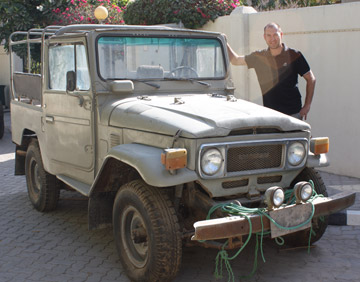 A few of the dusty old FJ45s sitting off the highway in Al Dhaid.